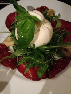 Burrata: solid mozzarella on the outside, mozzarella and cream in the inside