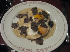 Fried eggs with black truffles and truffle cream