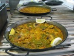 Paella waiting to be picked up by servers