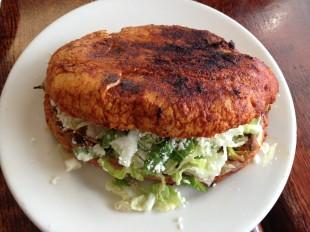 Pambazo with adobada (juicy shredded pork)