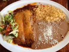 Red enchiladas with refried beans